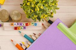 Colorful cube with word MARKETING PLAN on wooden desk. Business Campaign Concept background, colorful cube with word MARKETING PLAN on wooden desk royalty free stock image