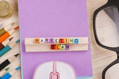 Colorful cube with word MARKETING PLAN on wooden desk. Business Campaign Concept background, colorful cube with word MARKETING PLAN on wooden desk stock image