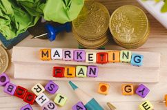 Colorful cube with word MARKETING PLAN on wooden desk. Business Campaign Concept background, colorful cube with word MARKETING PLAN on wooden desk royalty free stock images
