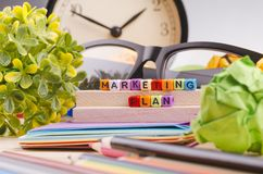 Colorful cube with word MARKETING PLAN on wooden desk. Business Campaign Concept background, colorful cube with word MARKETING PLAN on wooden desk stock photos