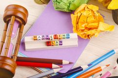 Colorful cube with word MARKETING PLAN on wooden desk. Business Campaign Concept background, colorful cube with word MARKETING PLAN on wooden desk royalty free stock photography