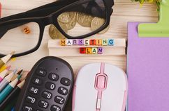 Colorful cube with word MARKETING PLAN on wooden desk. Business Campaign Concept background, colorful cube with word MARKETING PLAN on wooden desk stock images
