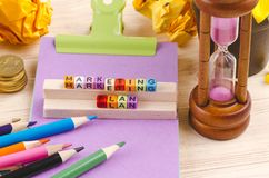 Colorful cube with word MARKETING PLAN on wooden desk. Business Campaign Concept background, colorful cube with word MARKETING PLAN on wooden desk stock photography