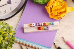 Colorful cube with word MARKETING PLAN on wooden desk. Business Campaign Concept background, colorful cube with word MARKETING PLAN on wooden desk stock photo