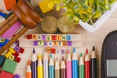 Colorful cube with word MARKETING TRATEGY on wooden desk. Business Campaign Concept background, colorful cube with word MARKETING STRATEGY on wooden desk royalty free stock image