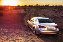 Japan Business car lexus gs f at sunset in the desert. Business car without logos at sunset in the desert. Back view royalty free stock image