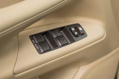 Business car window control buttons. Royalty Free Stock Image