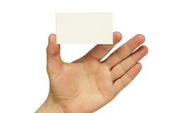 Business card. Empty business card in the hand isolated over white background Royalty Free Stock Photos