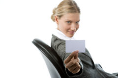 Business Card. Beautiful young woman holding a blank card Royalty Free Stock Photos