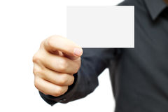 Business card. Businessmen in the dark shirt holding blank business card Stock Image