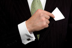 Business card. Business with his business card in his pocket Royalty Free Stock Images