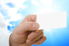 Business card. Blank business card in a hand Royalty Free Stock Photo