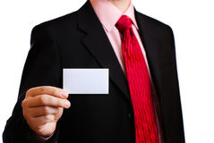 Business card. In his outstretched hand stock image