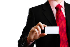 Business card. In his outstretched hand Royalty Free Stock Photography