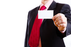 Business card. In his outstretched hand Royalty Free Stock Images