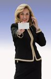 Business card. Attractive woman holding out blank card ready for text Royalty Free Stock Photos