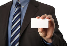 Business card. Businessman holding a blank business card in his hand Stock Photography