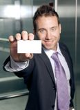 Business card. Handsome businessman showing blank business card