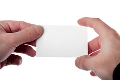 The business card. A hand holding a business card Royalty Free Stock Image