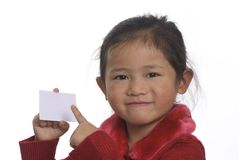 Business Card 3. A young girl hold up a business card and points at it Stock Photo