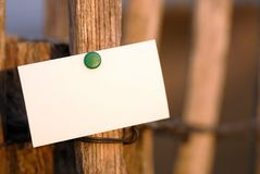 Business card. Message on wooden post in nature Stock Images