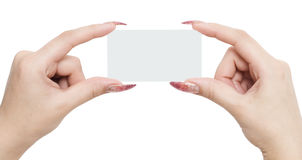 Business card. In a woman hands isolated on a white background Royalty Free Stock Images
