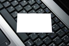 Business Card. White business card laid on a computer keyboard stock photo