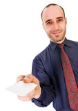 Business Card. Business man giving a blank card on white Royalty Free Stock Photography