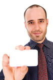 Business Card. Business man giving a blank card on white Royalty Free Stock Images