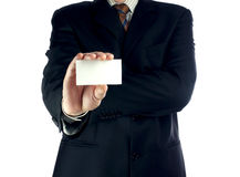 Business card. In a hand royalty free stock photos
