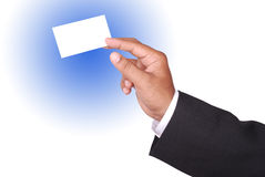 Business card. Businessman hands presenting the business card on blue background (path included Stock Photography