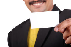 Business card. Businessman hands presenting the business card with smile stock photo