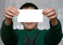 Business-card. Boy holds a business card royalty free stock images