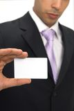 Business card. Businessman showing his card, space for messages Stock Image