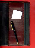 Business card on the agenda. Image of a business card and pen placed on the agenda stock images