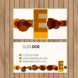 Business card with alphabet letter on a wood background Royalty Free Stock Image