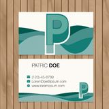 Business card with alphabet letter on a wood background Royalty Free Stock Images