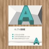 Business card with alphabet letter on a wood background Stock Photography