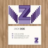 Business card with alphabet letter on a wood background Stock Photos