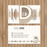 Business card with alphabet letter on a wood background Stock Photo