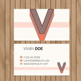 Business card with alphabet letter on a wood background Stock Images