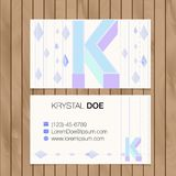 Business card with alphabet letter on a wood background Royalty Free Stock Photo