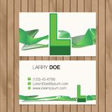 Business card with alphabet letter on a wood background Royalty Free Stock Photos