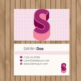 Business card with alphabet letter on a wood background Stock Image