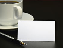 Business Card And A Coffee Cup Royalty Free Stock Photos