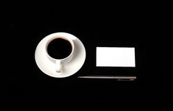 Business card on a black table. Business card template on a table with a cup of coffee stock photos
