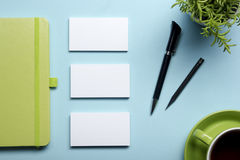 Free Business Card Blank, Notepad, Flower, Coffee Cup And Pen At Office Desk Table Top View. Corporate Stationery Branding Royalty Free Stock Photos - 69021078