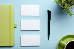 Free Business Card Blank, Notepad, Flower, Coffee Cup And Pen At Office Desk Table Top View. Corporate Stationery Branding Royalty Free Stock Photos - 69455758
