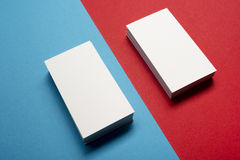 Business card blank over colorful abstract background. Corporate stationery branding mock-up Stock Images