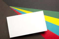 Business card blank over colorful abstract background. Corporate stationery branding mock-up Stock Photography